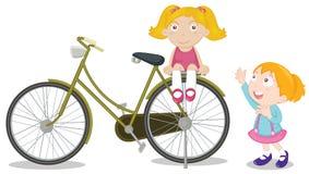 Kinder auf einem Fahrrad Lizenzfreie Stockfotografie