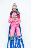 Kinder auf Pendelschlitten Lizenzfreie Stockbilder