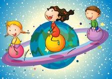 Kinder auf Planeten Lizenzfreies Stockbild
