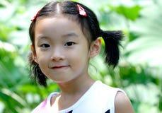 Kinder in den Gärten Lizenzfreie Stockbilder