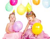 Kinder in den Partyhüten Stockbilder