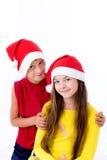 Kinder in den Weihnachtsschutzkappen Lizenzfreie Stockbilder