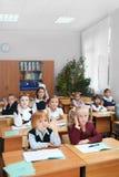 Kinder an der Schule Stockbild