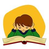 Kinder in der Schule - Junge liest Stockbilder