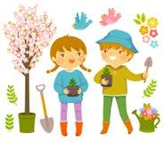 Kinder, die Anlagen pflanzen stock abbildung