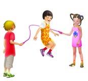 3 Kinder, die das Spaßseilüberspringen haben Stockfotografie