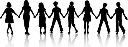 Kinder, die Hände anhalten Stockbild