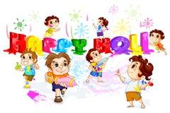 Kinder, die Holi Festival spielen Stockfoto