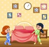 Kinder, die morgens Bett machen Stockbilder