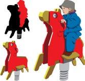 Kinder, die Schwingpferd reiten Stockbild