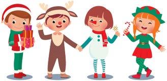 Kinder, die Weihnachten in den Weihnachtskostümen feiern Lizenzfreies Stockfoto