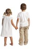 Kinder, die zurück stehen Stockfotos