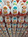 Kinder eggs. Big stack of Kinder eggs in supermarket store prepared for Easter holiday stock image