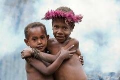 Kinder eines Dani Stammes. stockbild