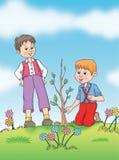 Kinder kümmern sich um der Anlage Stockbild