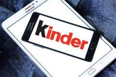 Kinder logo. Logo of chocolate brand kinder on samsung mobile phone on samsung tablet royalty free stock photography