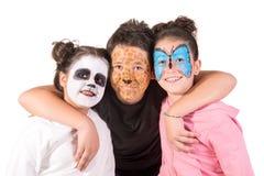 Kinder mit Gesichtfarbe stockfoto