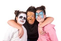 Kinder mit Gesichtfarbe stockfotografie