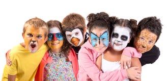 Kinder mit Gesichtfarbe stockfotos