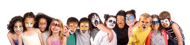 Kinder mit Gesichtfarbe lizenzfreies stockbild