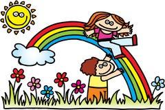 Kinder mit Regenbogen Stockfotos