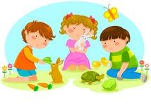 Kinder mit Tieren Stockfoto