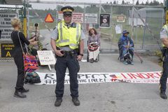 Kinder Morgan protesters demonstrate against the Kinder Morgan pipeline expansion in Burnaby, BC. Protesters against the Kinder Morgan pipeline expansion await stock image