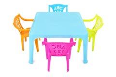 Kinder verlegen u. Stühle Lizenzfreies Stockfoto