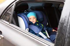 Kinderauto-Schutzsitz stockfoto