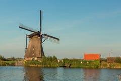 Kinderdijk canals with windmills. Sunset in Dutch village Kinder Stock Photos