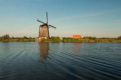Kinderdijk canals with windmills. Sunset in Dutch village Kinder Stock Photo