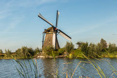 Kinderdijk canals with windmills. Sunset in Dutch village Kinder royalty free stock photo