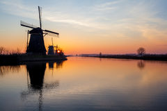 Kinderdijk in holland. On the water there are several windmills in Kinderdijk in Holland Stock Image