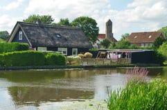 Kinderdijk. Typical thatched cottage in kinderdijk village in netherlands Royalty Free Stock Images