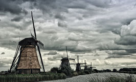 Kinderdijk windmill. Windmill in Kinderdijk in Holland and blue sky with clouds Royalty Free Stock Photos
