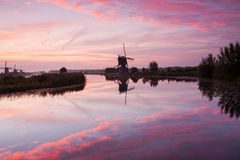 Kinderdijk windmill at sunrise Royalty Free Stock Photo