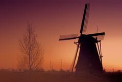 Kinderdijk - Windmills. Kinderdijk is a village in the Netherlands, partly in the municipality Nieuw-Lekkerland, partly in the municipality of Alblasserdam, in Royalty Free Stock Images