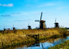 Kinderdijk Windmills. A group of windmills in the town of Kinderdijk in the Holland Royalty Free Stock Photo