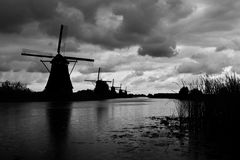 Kinderdijk Windmills. A row of windmills at Kinderdijk during the onset of a storm in South Holland Stock Photography