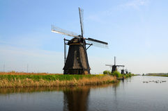 Kinderdijk windmills. UNESCO Heritage site - Kinderdijk,  a village which drains its polder with 19 windmills built around 1740. It is the  largest group of old Stock Photography