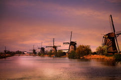 Kinderdijk windmills. UNESCO Heritage site - Kinderdijk,  a village which drains its polder with 19 windmills built around 1740. It is the  largest group of old Royalty Free Stock Image