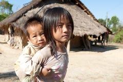 Kinderen in armoede Stock Foto's