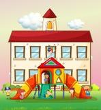 Kinderen die dia spelen op school Royalty-vrije Stock Afbeelding
