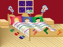Kinderen die op de avond van Kerstmis dromen Stock Afbeeldingen
