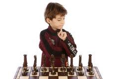 Kinderen die in schaak spelen Stock Foto's