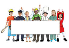 Kinderen die Toekomstig Job Uniforms dragen Stock Fotografie