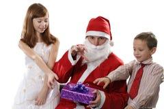 Kinderen en Kerstman Stock Foto's