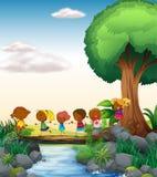 Kinderen en rivier Stock Foto