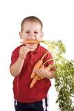 Kinderen en wortelen Royalty-vrije Stock Afbeelding