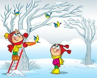 Kinderen gevoed vogels in de winter Royalty-vrije Stock Afbeelding